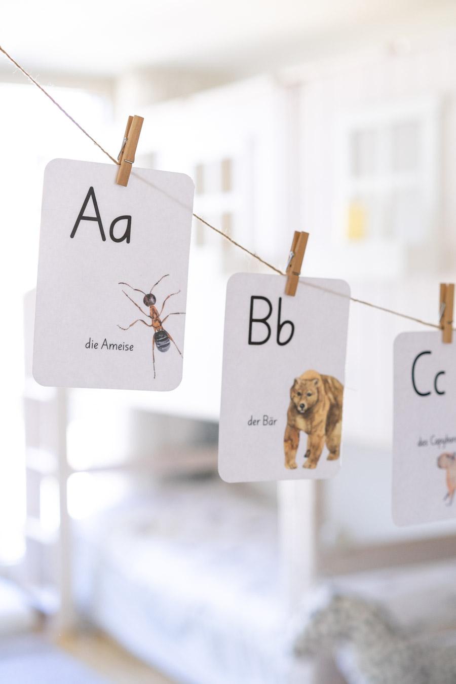 Eine Idee für die Sprachentwicklung: Buchstaben als ansprechende Girlande aufhängen